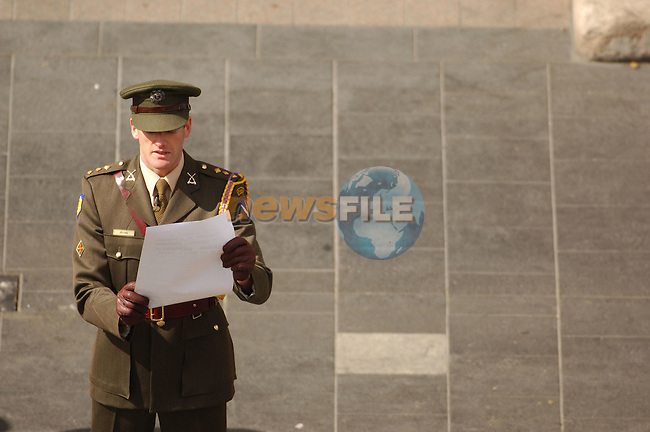 Dublin Ireland, Easter Sunday 1916 Rising Commemoration parade. 90th anniversary of the Irish Rising against British Rule in Ireland. A soldier reads out the proclamation of Irish Independence outside the Dublin GPO (General Post Office)..Photo AFP/NEWSFILE/BARRY CRONIN..(Photo credit should read AFP PHOTO BARRY CRONIN/NEWSFILE)...This Picture has been sent you under the condtions enclosed by:.Newsfile Ltd..the Studio,.Millmount Abbey,.Drogheda,.Co Meath..Ireland..Tel: +353(0)41-9871240.Fax: +353(0)41-9871260.GSM: +353(0)86-2500958.email: pictures@newsfile.ie.www.newsfile.ie.FTP: 193.120.102.198..This picture is from pictures@newsfile.ie
