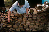 Cuba, March 1992: Man at the color selection for the Montecristo #2 in La Corona, The largest cigar factory in Havana.