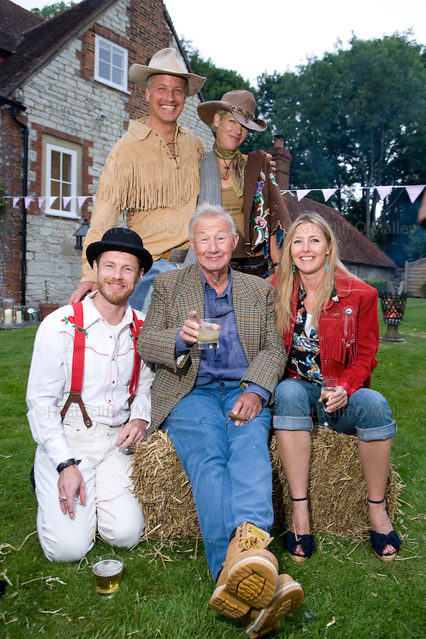 Dow0014121 . Daily Telegraph..Sophie and Tom Conran ,their spouses Nick and Cynthia(back row) and their father Terence Conran at a summer party in west Sussex ..West sussex 6 June 2009
