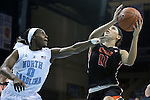16 December 2014: Oregon State's Gabriella Hanson (11) and North Carolina's Jamie Cherry (0). The University of North Carolina Tar Heels hosted the Oregon State University Beavers at Carmichael Arena in Chapel Hill, North Carolina in a 2014-15 NCAA Division I Women's Basketball game. Oregon State won the game 70-55.