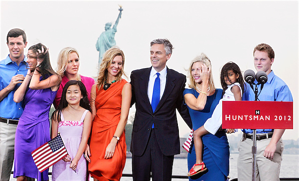 Jersey City, New Jersey: June 21, 2011<br /> Presidential candidate Jon Huntsman and family occupy a stage moments after his declaring his candidacy for the presidency of the United States. From left to right are children Jon III, Abigail (Abby), Elizabeth, Gracie Mei, Mary Anne, wife Mary Kaye Huntsman, and children Asha and William (Will). The Statue of Liberty is situated behind them. This event happened at Liberty State Park. &copy;Chris Fitzgerald / Candidate Photos