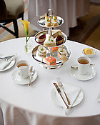 Afternoon tea at the Umstead Hotel & Spa features a tower of tea sandwiches - cucumber and sherry cream chease, chicken sesame salad, house smoked salmon with créme fraiche, sundried tomato basil tapenade and deviled quail eggs.