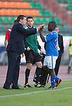 St Johnstone v FC Minsk...01.08.13 Europa League Qualifier at Neman Stadium, Grodno, Belarus...<br /> Tommy Wright high fives Nigel Hasselbaink as he is subbed<br /> Picture by Graeme Hart.<br /> Copyright Perthshire Picture Agency<br /> Tel: 01738 623350  Mobile: 07990 594431