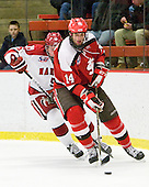 Dan Ford (Harvard - 5), Nic Vangog (St. Lawrence - 14) - The Harvard University Crimson defeated the St. Lawrence University Saints 4-3 on senior night Saturday, February 26, 2011, at Bright Hockey Center in Cambridge, Massachusetts.