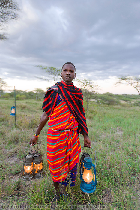 Masai tribesman with lanterns, Serengeti National Park, Tanzania, East Africa
