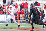 College Park, MD - November 26, 2016: Rutgers Scarlet Knights quarterback Giovanni Rescigno (17) rolls out the pocket to throw a pass during game between Rutgers and Maryland at  Capital One Field at Maryland Stadium in College Park, MD.  (Photo by Elliott Brown/Media Images International)