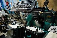An antique German printing machine Heidelberg running in the state print shop, Santiago de Cuba, Cuba, 4 August 2008.