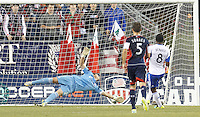New England Revolution substitute goalkeeper Bobby Shuttleworth (22) fails to stop second penalty kick score by Montreal Impact. In a Major League Soccer (MLS) match, Montreal Impact (white/blue) defeated the New England Revolution (dark blue), 4-2, at Gillette Stadium on September 8, 2013.