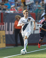 LA Galaxy midfielder Greg Cochrane (35) dribbles down the wing. In a Major League Soccer (MLS) match, the New England Revolution (blue) defeated LA Galaxy (white), 5-0, at Gillette Stadium on June 2, 2013.