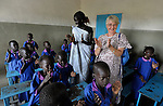 Students sing a song in a Catholic school in Malakal, Southern Sudan. Encouraging them is their teacher, Regina John Thabo (center), who is studying to be a better teacher in a program sponsored by Solidarity with Southern Sudan, an international network of Catholic groups supporting Southern Sudan with educational personnel and prayer. Irish Sister Elizabeth Ryan, FCJ (right), supervises Thabo's progress. NOTE: In July 2011 Southern Sudan became the independent country of South Sudan.