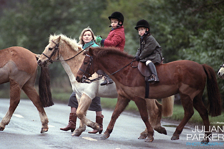 Prince William, and Prince Harry, on Ponies at Sandringham, in Norfolk, accompanied by their nanny..