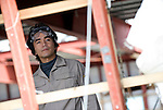 Fisherman Kenichiro Yagi gets to work on a new HQ -- inside the ruins of a 24-hour store -- for his business in Ofunato, Iwate Prefecture, Japan on 07 April, 2011. Yagi plans to open up an online marine products venture in the quake and tsunami-stricken city..Photographer: Robert Gilhooly