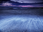 Beautiful dramatic dark blue sunset scenery of lake Huron, Pinery Provincial Park, Grand Bend, Ontario, Canada.