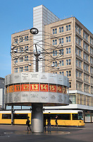 The Weltzeituhr or World Clock, 1969, by Erich John, displaying the time in cities around the world and a model of the solar system above, Alexanderplatz, Berlin, Germany. Behind is an U-Bahn or underground train and the Berolinahaus, built 1929-32 by Peter Behrens, used for retail and offices, a classical modernist building protected since 1975 as an example of the Neuen Sachlichkeit or New Objectivity style. Picture by Manuel Cohen