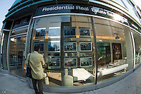 A prospective buyer browses a real estate brokers listings in New York on Thursday, September 13, 2012 (© Frances M. Roberts)