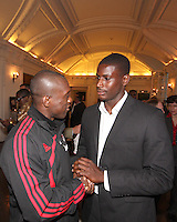 Bill Hamid of DC United with Clarence Seedorf of AC Milan at a reception for AC Milan at DAR Constitution Hall in Washington DC on May 24 2010.