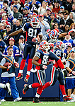 1 November 2009: Buffalo Bills' wide receiver Terrell Owens (81) jumps high as he celebrates a first quarter touchdown against the Houston Texans at Ralph Wilson Stadium in Orchard Park, New York, USA. The Texans defeated the Bills 31-10. Mandatory Credit: Ed Wolfstein Photo