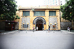 "The entrance to the former Hoa Lo prison in Hanoi, Vietnam. Known as the ""Hanoi Hilton"" to U.S. pilots held there after being shot down during the Vietnam War, most of the structure was demolished after the conflict ended. The museum focuses primarily on the brutal conditions under which Vietnamese political prisoners were held during the French colonial era. Oct. 27, 2012."