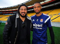 Ma'a Nonu and Winston Reid during the West Ham United training session at Westpac Stadium, Wellington, New Zealand on Friday, 25 July 2014. Photo: Dave Lintott / lintottphoto.co.nz