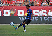Manchester United midfielder Nani (17) chips the ball over Chicago Fire goalkeeper Jon Conway (not pictured) to score Manchester United's third goal.  Manchester United defeated the Chicago Fire 3-1 at Soldier Field in Chicago, IL on July 23, 2011.