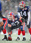 3 January 2010: Buffalo Bills' center Geoff Hangartner (63) prepares to snap the ball to quarterback Ryan Fitzpatrick (14) during a game against the Indianapolis Colts during a cold, snowy, final game of the season at Ralph Wilson Stadium in Orchard Park, New York. The Bills defeated the Colts 30-7. Mandatory Credit: Ed Wolfstein Photo