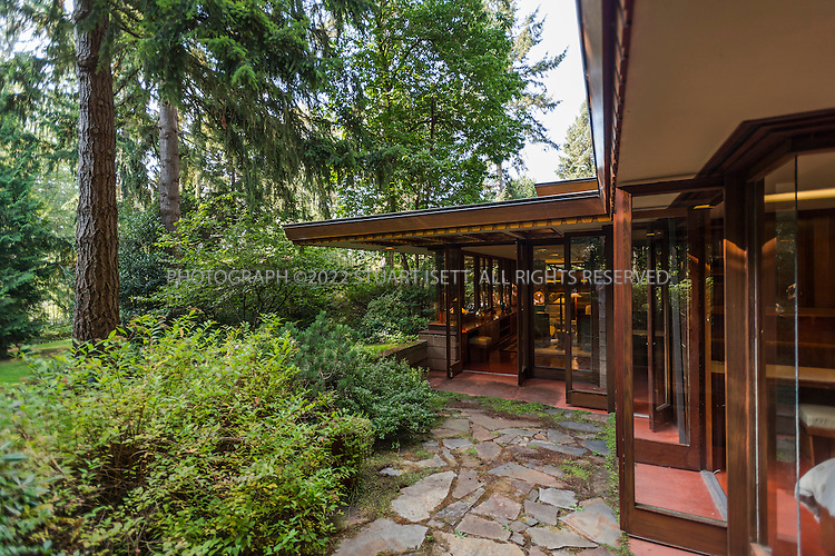 """10/9/2012--Sammamish, WA, USA..VIEW: Exterior view...Architect Frank Lloyd Wright planned his """"Usonian"""" homes to be affordable for middle-class families. The 1,950 square foot Brandes home is for sale in Sammamish, Washington (30 minutes from Seattle) at $1.39 million. It features three bedrooms, two bathrooms and a small, separate office/study space...The home was built in 1952, and has redwood trim and Wright's original furniture and some garden sculptures by Wright. It's one of only three Frank Lloyd Wright homes near Seattle...©2012 Stuart Isett. All rights reserved."""