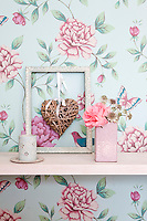 Graham & Brown floral print wallpaper adorns the walls of the living room