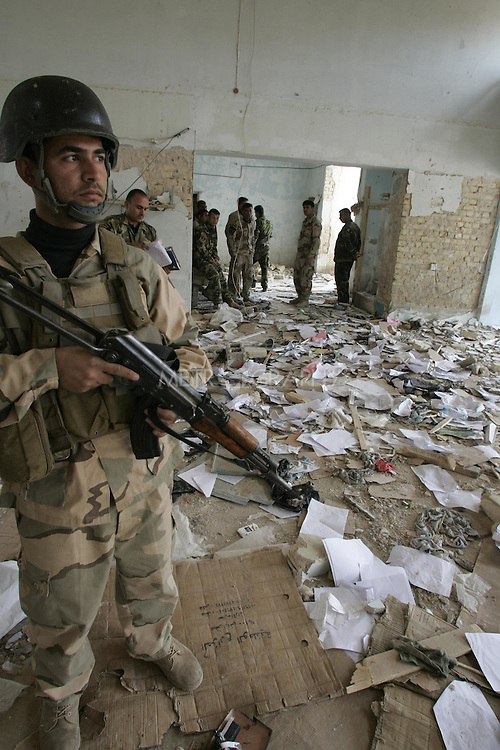 BAQUBA, IRAQ:  Security forces examine a damaged building after a series of bombings in the Iraqi city of Baquba...Three bombs went off in Baquba, the capital of Diyala Province, killing at least 30 people.  The first two bombs were at 9: 30 in the morning.  The third bomb was at a local hospital where the victims were being taken...Photo by Metrography.
