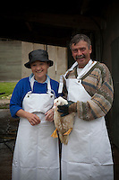 Portrait of two farmers with a duck destined for the cassoulet pot