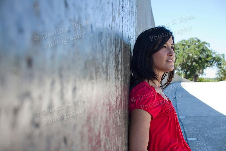 american indian girl posing in red shirt