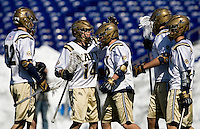 Tim Paul (14) celebrates a goal with teammate (32) Evan Sullivan of Navy at the Navy-Marine Corp Memorial Stadium in Annapolis, Maryland.   Loyola defeated Navy, 8-7, in overtime.