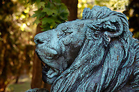 Detail of the statue called Lion de menagerie baillant, un chien entre les pattes (menagerie lion yawning with a dog in his legs), created by Henri Jacquemart circa 1857 and located at the bottom of the Labyrinth in the Jardin des Plantes, Paris, 5th arrondissement, France. This statue by Henri Jacquemart was probably inspired by the famous menagerie lion Woira, a Senegalese lion who was inseparable from his dog companion. Founded in 1626 by Guy de La Brosse, Louis XIII's physician, the Jardin des Plantes, originally known as the Jardin du Roi, opened to the public in 1640. It became the Museum National d'Histoire Naturelle in 1793 during the French Revolution.