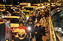 Workers Try to Walk Home at 10.06 pm in Tokyo as Public Transport is suspended after a huge M8.9 earthquake hit Japan on Friday 11th March, 2011 followed by a giant tsunami causing death and destruction. Over 100,000 people could not return home in the capital and many spent the night in temporary shelters