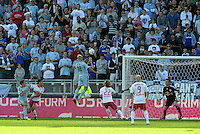 Sporting KC defender Aurelien Collin has a head on the Red Bull goal...Sporting Kansas City defeated New York Red Bulls 2-0 at LIVESTRONG Sporting Park, Kansas City, Kansas.