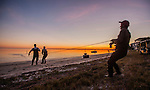 Commercial mullet fishermen play their trade off the beach at Shell Point Beach in Wakulla County, Florida along the Florida panhandle.