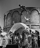 """April 1968, Manhattan, New York City, New York State, USA. Actors are tossed up into the air using blankets in a scene from Jean-Louis Barrault's """"Carmen Noire"""". It is being performed in New York's Metropolitan Opera House. Image by © JP Laffont"""