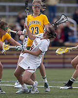 University of Vermont defender Danielle O'Dwyer (15) decks Boston College midfielder Sam Taylor (14). Boston College defeated University of Vermont, 15-9, at Newton Campus Field, April 4, 2012.