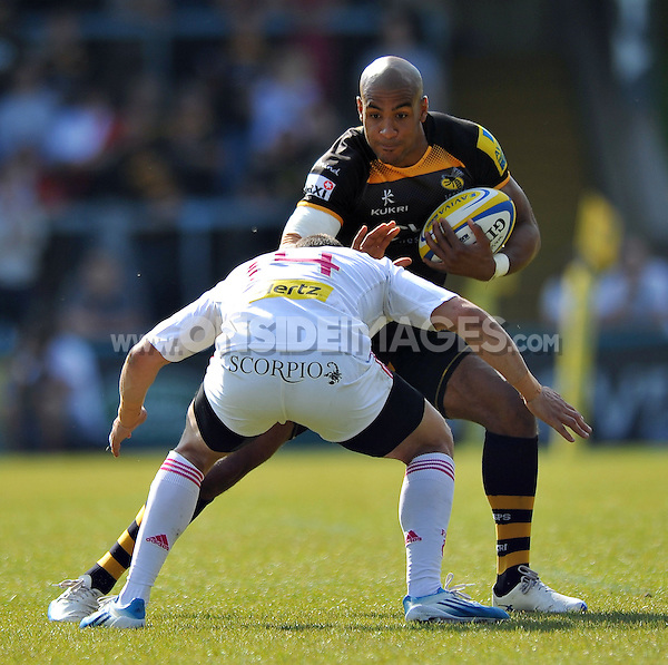 Tom Varndell looks to fend Julien Arias. European Champions Cup play-off, between London Wasps and Stade Francais on May 18, 2014 at Adams Park in High Wycombe, England. Photo by: Patrick Khachfe / JMP