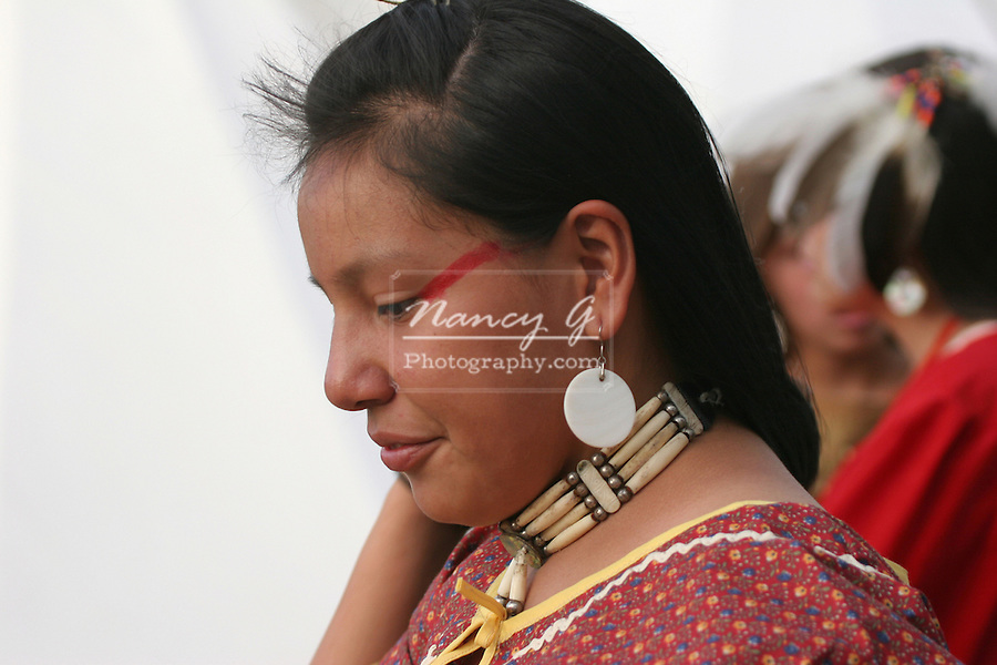 A Native American Indian woman with red paint on her face