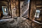 Abandoned lunatic asylum north of Berlin, Germany. Chair with stairs