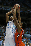 30 December 2015: Clemson's Jaron Blossomgame (right) guards North Carolina's Brice Johnson (11). The University of North Carolina Tar Heels hosted the Clemson University Tigers at the Dean E. Smith Center in Chapel Hill, North Carolina in a 2015-16 NCAA Division I Men's Basketball game. UNC won the game 80-69.