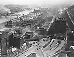 Pittsburgh PA:  View of uptown and Penn Station from the new Koppers Building - 1929.  For only a few years, Penn Station had a Pennsylvania Railroad sign on the side of the building. Strip District of Pittsburgh in the background.