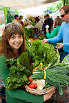 The extremely popular Saturday Portland Farmers' Market, located in the South Park Blocks near the Portland State University Campus, offers a large selection of locally grown organic produce, fish, meat and foodstuffs.  Pictured here is Vanessa Gregor with a basket of fresh produce from the Gathering Together Farm stand.