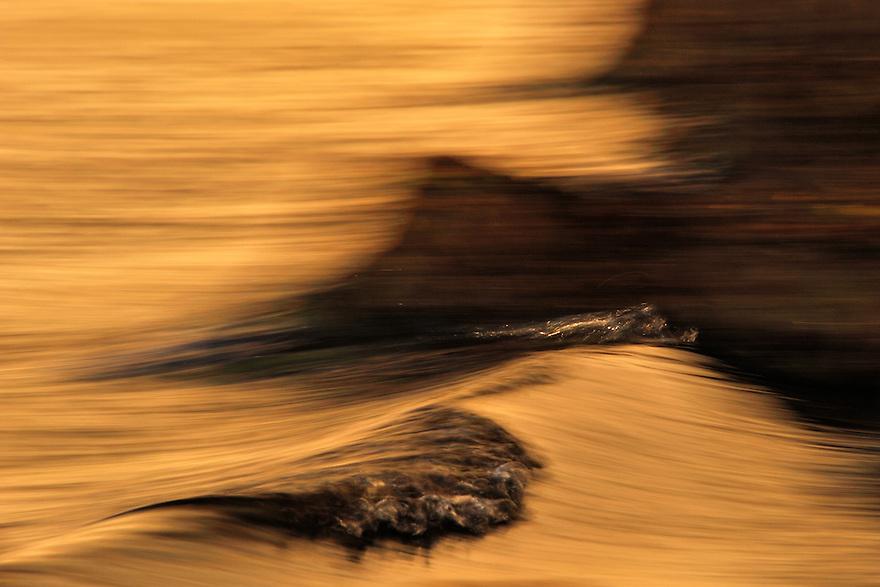 Reflection of chalk cliff in water at Gråryg Fald - Møns Klint, Denmark