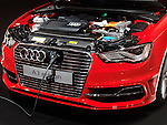 Closeup of Audi A3 e-tron electric car with a power plug being charged