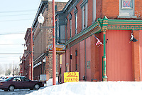 A sign directs snowmobiles to parking in downtown Calumet.