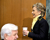 """Washington, DC - April 8, 2008 -- United States Senator Hillary Rodham Clinton (Democrat of New York), left, walks past United States Senator Edward M. """"Ted"""" Kennedy (Democrat of Massachusetts), lower left, without acknowledging him prior to hearing the testimony of General David Petraeus and Ambassador Ryan Crocker before the United States Senate Armed Services Committee on the situation and progress in Iraq in Washington, D.C. on Tuesday, April 8, 2008..Credit: Ron Sachs / CNP"""