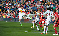 New York midfielder Eric Alexander (12) plays the ball in the air.  The Chicago Fire defeated the New York Red Bulls 3-1 at Toyota Park in Bridgeview, IL on April 7, 2013.