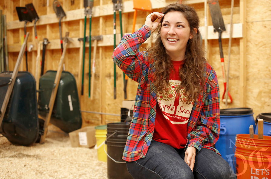 NWA Democrat-Gazette/DAVID GOTTSCHALK   Destiny Schlinker, program manager for Apple Seeds Inc., sits Wednesday, May 25, 2016, in the barn as she describes  the operation of the teaching farm in Fayetteville.