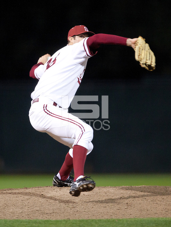 STANFORD, CA - February 23, 2011: Scott Snodgress of the Stanford baseball team pitches during Stanford's home opener against California at Sunken Diamond. Stanford won 3-2.